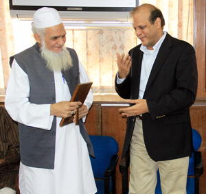 Abdul Jabbar (left)  receives a plaque from Dawn's editor Zaffar Abbas at the farewell party held for him.