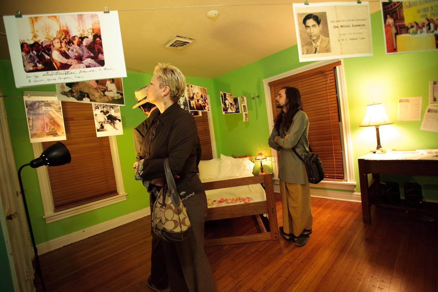 "Audience members viewing Sehba Sarwar's installation ""Listening from Within"" at the show, Honoring Dissent/Descent, she created to honor her father, Dr. Mohammad Sarwar, November 2009 - by Eric Hester."